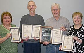 Displaying NPA awards are, l. to r., Datrece Voichoski, Joe Flanagan, and Jim and Julie Dickerson.