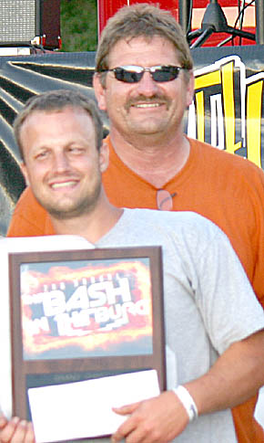 Overall barbecue grand champion Nick Wolfe of Norfolk (front) with 'Bash in the Burg' committee member Larry Temme.
