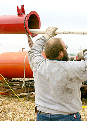 A contestant from York, NE, loads a pumpkin into his air canon at Punkin' Chunkin'.