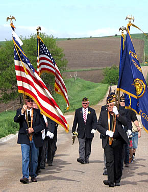 Petersburg color guard marches to the Petersburg Cemetery.