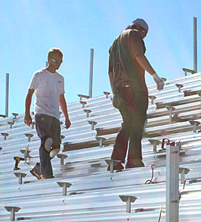 Workers installing bleachers last week at Boone Central field.