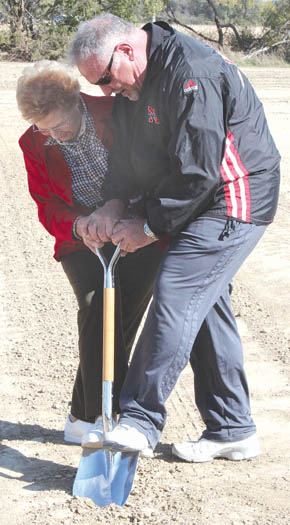 Randy Christo and his mother, Jackie, turn the first shovel of dirt for the new Cardinal Inn.