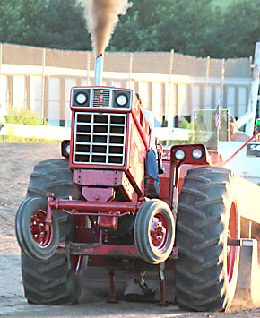 Walt Hoefer's tractor stands on two wheels at the start of his run in the Boone County Fair Tractor Pull.