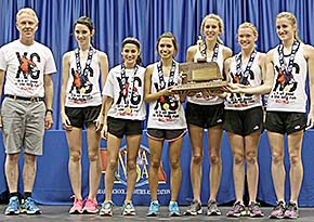 Collecting their state cross country championship trophy (l.-r.) Coach Tom Dickey, Jessica Weeder, Christina Stopak, Kendra Gonzales, Sheldon Beierman, Taylor Starman and Catherine Weeder.