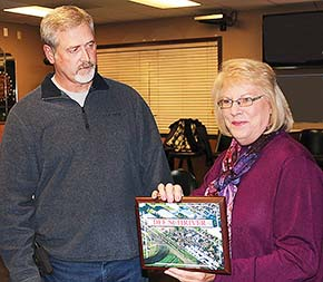 Dave Noble, fair board president, presents a 25-year plaque to Dee Schriver.