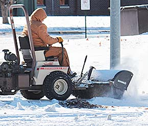 Rod Nelson clears snow from the courthouse square sidewalks.
