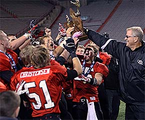 BC/NG football team hoists the championship trophy after their big victory Tuesday.