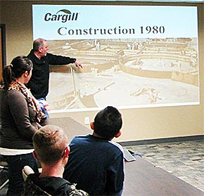 Terry Reicks, manager of Cargill Albion, explains recent expansions at the plant to students and Business and Industry Day.