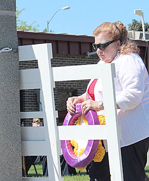 Donna Iwan places the Gold Star Mothers wreath during Memorial Day services in Albion.