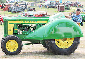 SHOW STOPPER -- Duane Filsinger of Clearwater with his JD 620 orchard tractor.