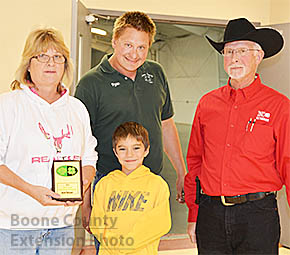 Arlene Neidhardt (left) received the 2015 Boone County Heart of 4-H Award during the recent Boone County 4-H Achievement. Also pictured are Ryan Neidhardt, back, Gracin Connelly and Steve Pritchard, Nebraska Extension Educator, right.