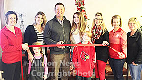 Spann family welcomed with ribbon cutting.
