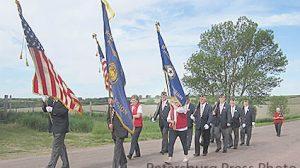 Petersburg Legion and Auxiliary members march to the cemeteries on Memorial Day.
