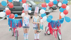 Mckenna and Evy Aalbers wond the first place trophy at the July 4th Kiddie Parade in Albion.
