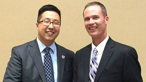 Dr. Joel Travis, right, accepts distinguished faculty award from Howard Liu, MD, Assistant Vice Chancellor at the Premier Education Banquet at UNMC in Omaha.