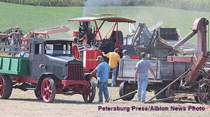 Threshing powered by a steam tractor is one of the attractions at Rae Valley Days.