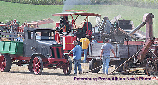 Threshing powered by a steam tractor was one of the displays at Rae Valley Days.