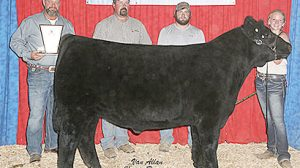 Emily Groeteke, right, with her grand champion steer.