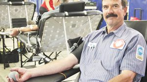Mark Swiatek reached the 13-gallon mark in total blood donations during the Sept. 12 drive.