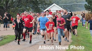 Runners leave the starting line in the 'Hicks from the Sticks' mud run.