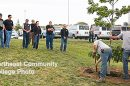 Students in Northeast Community College's heating, ventilation and air conditioning (HVAC) program and others watch as Northeast grounds crew members plant a tree in memory of their classmate, Carter Johnson of Newman Grove, who died earlier this year. The red oak sits just outside the HVAC Lab in the Applied Technology building on the Northeast campus in Norfolk.