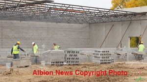 Boone Central construction project continues with erection of exterior walls and installation of roof joists.