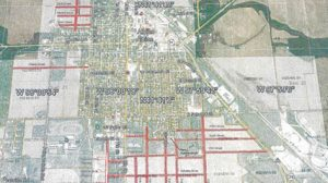 Red lines indicate future locations for city streets.