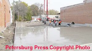 Concrete pouring underway for a new spec building in downtown Petersburg.