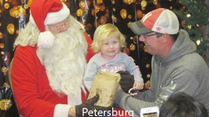 Braelyn Thieman and her father, Ben, were among those visiting with Santa Claus.