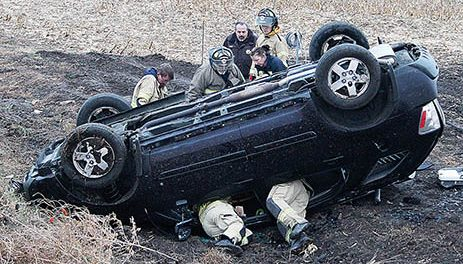 Firemen work to remove driver James Sock after the roll-over accident Dec. 3.