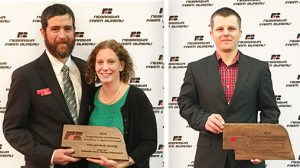 Beth Janning, l., and her husband Paul, r., received the Nebraska Farm Bureau Young Farmer and Rancher Excellence Award.