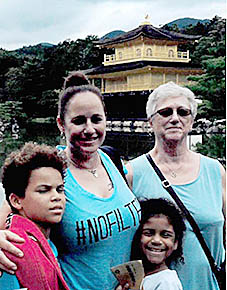 AT GOLDEN PALACE -- Judy Petsche, right, with her daughter, Carrie, and grandchildren Savai and Kenya, in front of the Golden Palace.