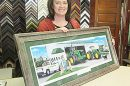 Jean Olson with an example of a barnwood framed print that she recently completed.