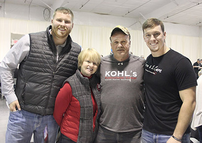 """University of Nebraska offensive lineman Sam Hahn of DeWitt, along with (l.-r.) Jill and Gerald Foltz of Greeley County, parents of late NU punter Sam Foltz, were special guests of honor at a """"Feed the World Tour"""" fundraiser. With them (right) is Farm 4 A Cure organizer Donny Baker."""