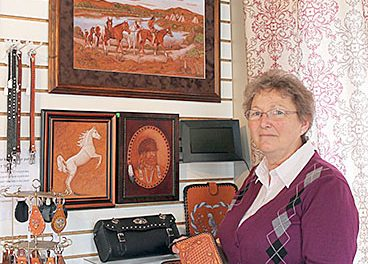 Karen Siems with some of the leather items available at her store.