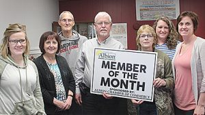 """The Albion News was honored by the Albion Chamber of Commerce as """"member of the month"""" for April. Presenting the sign last week were Courtney Stephan, l., chamber office coordinator, Barb Krohn, chamber president, and Shelley Lueken, board member. Albion News staff members are (l.-r.) Julie Dickerson, Joe Flanagan, Jim Dickerson and Chrissy Rasmussen."""