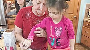 Carola Reigle makes a basic cinnamon-sugar pie with great-granddaughter Aubrey Mauch.
