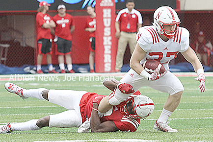 Wyatt Mazour slips a tackle in the Cornhusker spring game.