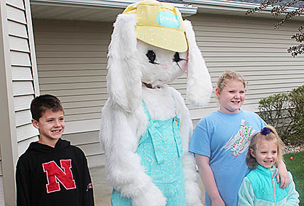 Posing for a picture with the Easter Bunny last Saturday were, l.-r., Camden, Nyla and Karrah, children of David and Amanda Redler of Albion.