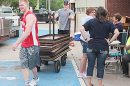 Loading tables and furniture into trailers outside Boone Central Elementary.