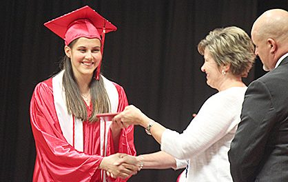 Boone Central graduate Elizabeth Hauger accepts her diploma from School Board President Patti Meyer.