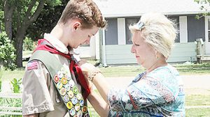 Walker Stuhr's Eagle Scout medal is pinned on by his mother, Connie.