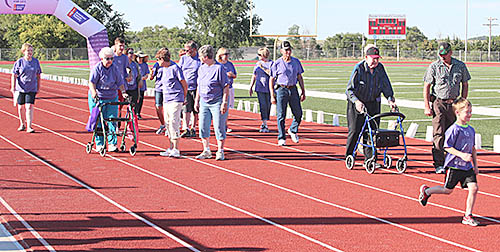 About 30 cancer survivors walked the first lap to open the annual Boone County Relay for Life Sunday evening, June 25, on the Boone Central track.