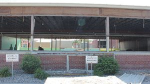 CLEAR VIEW -- With demolition completed last week, passers-by could see all the way through the 1956 elementary wing at Boone Central Public Schools. Only the steel roof and portions of the exterior walls remained in place. Build-back of the new classroom areas is expected to begin soon, and all new windows will be installed.