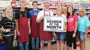 Don Casper (center) accepts the Member of the Month award from Chamber President Barb Krohn. Looking on are, l.-r., Chamber Coordinator Courtney Stephan, ThirftyWay employees Eric Casper, Thomas Hosford, Jane Prothman and Bailey Reigle, and Chamber board member Lori Krohn.