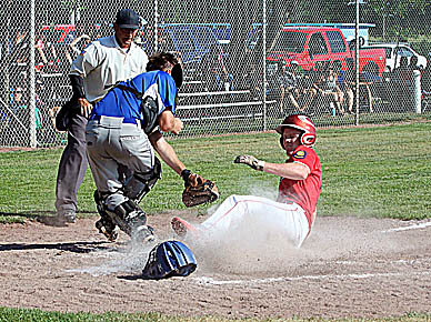 Noah Valasek of Albion Cornerstone slides in safely for a run during opening-round action in the American Legion Class C Area 6 Tournament at Palmer Friday.