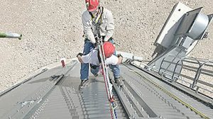 Members of the CVA rope rescue team lower themselves to the ground.