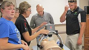 Petersburg Rescue Unit personnel (l.-r.) Kim Fangman, Karrie Fogelman, Dr. Sean Kohl and Jared Seier practice with the new equipment.