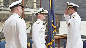 CHANGE OF COMMAND -- Captain Bruce A. Gragert, right, salutes, l.-r., Rear Admiral John Hannink, presiding officer, and Captain Eric C. Price during the Aug. 4 ceremony.