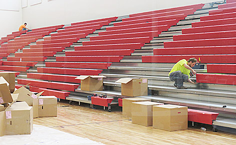 Finish work was underway last week on the bleachers in the new gym.
